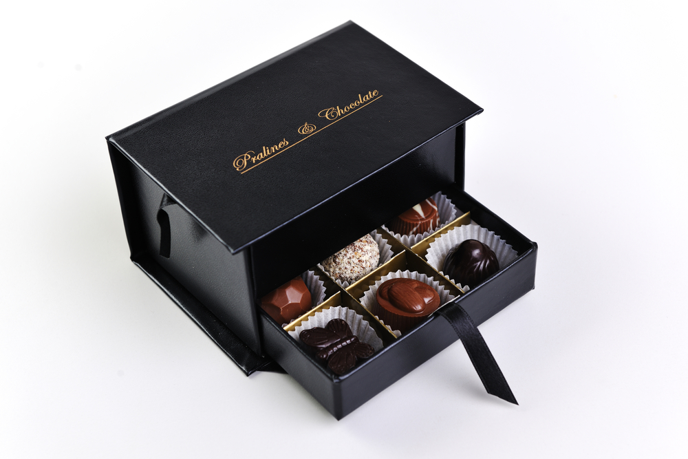 chocolate and praline luxury box with candy and sweets